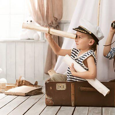kids in a suit case exploring